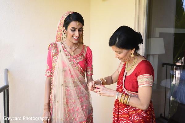 Maharani putting her bangles on.