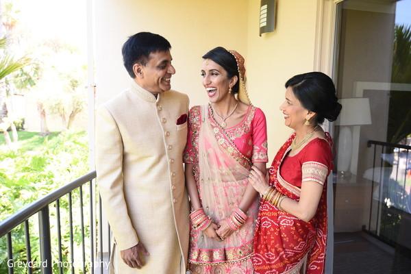 Joyful Indian bride with parents capture.