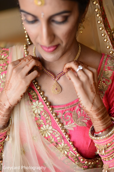 Stunning Indian bride with her jewelry on.