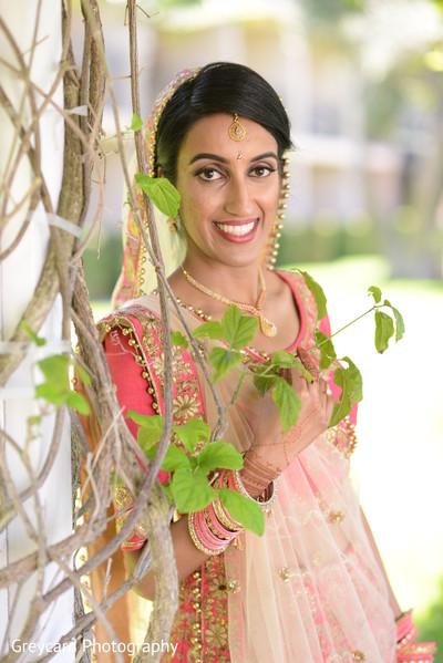 Gorgeous Indian bride on her ceremony wedding lehenga.