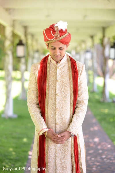 Sweet Indian groom about to meet the bride.