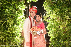 Glowing couple on their Indian wedding ceremony fashion.