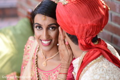 Gorgeous Indian bride  and groom with traditional outfits.
