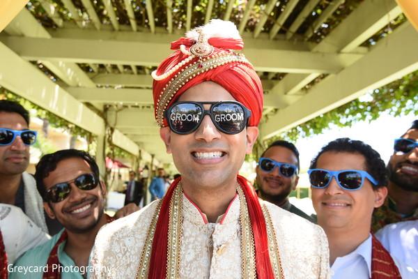 Charming Indian groom warring baraat sunglasses.