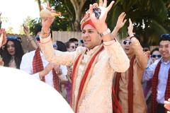 Indian groom at his baraat celebration capture.