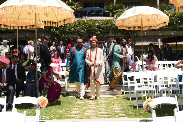 Grand entrance of Indian groom at ceremony.