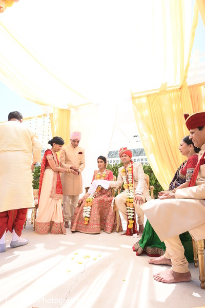 Indian bride and groom at their ceremony ritual.