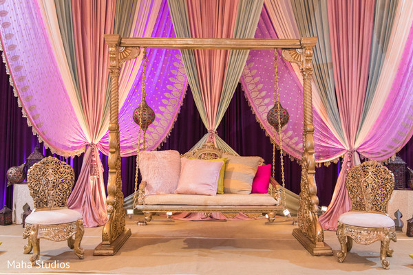 Incredible golden and pink sangeet stage decoration.