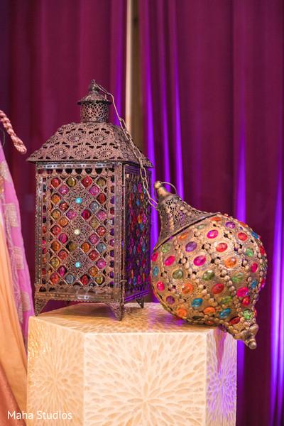Colorful gems on Sangeet brass lanterns.
