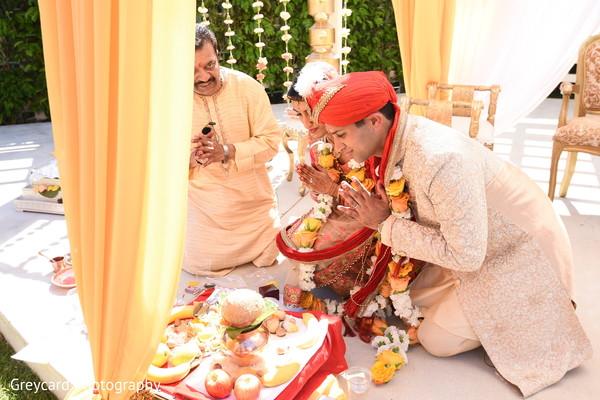 Indian wedding coconut ritual capture.