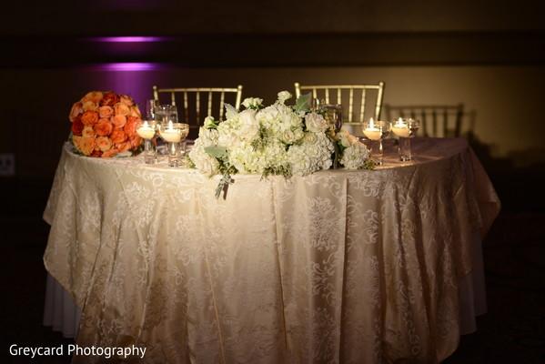 Elegant Indian wedding flowers table decoration.