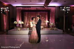 Glamorous Indian bride and groom at reception.