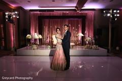 Ravishing Indian couple's in their wedding reception attire.
