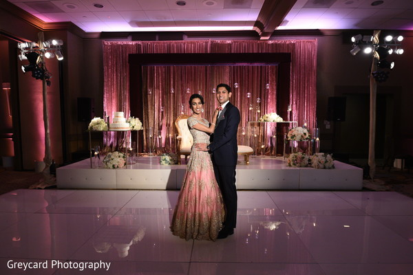 Ravishing Indian couple's in their wedding reception attire.