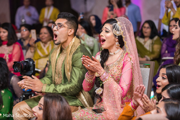 Impressed Indian couple at sangeet show.