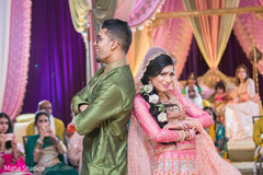 Indian bride and groom at a sangeet choreography.