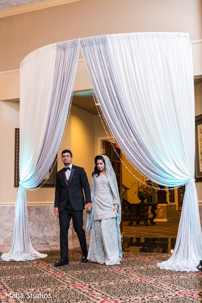 Lovely Indian couple making their entrance to the wedding reception.