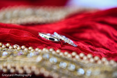 Stunning Indian wedding rings capture.