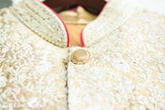 Marvelous Indian groom's sherwani closeup capture.
