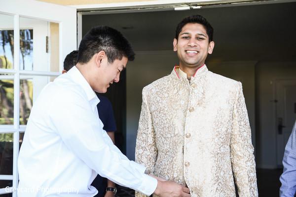 Enchanting Indian groom getting ready.
