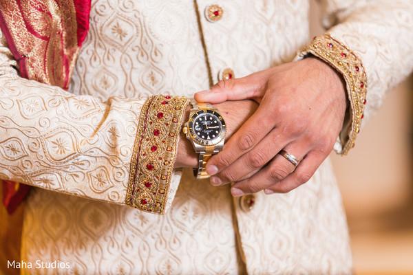 Closeup capture of indian groom's watch.