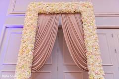 Indian wedding floral entrance decoration.
