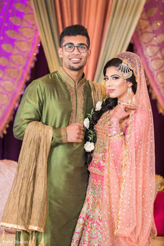 See this lovely Indian couple on their sangeet outfits.