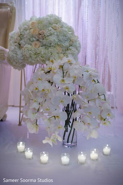 Floral arrangement details and candle ornaments