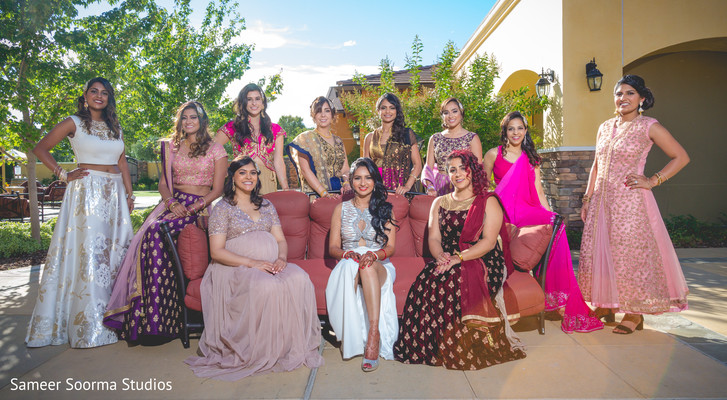 Bridesmaids posing with Indian bride