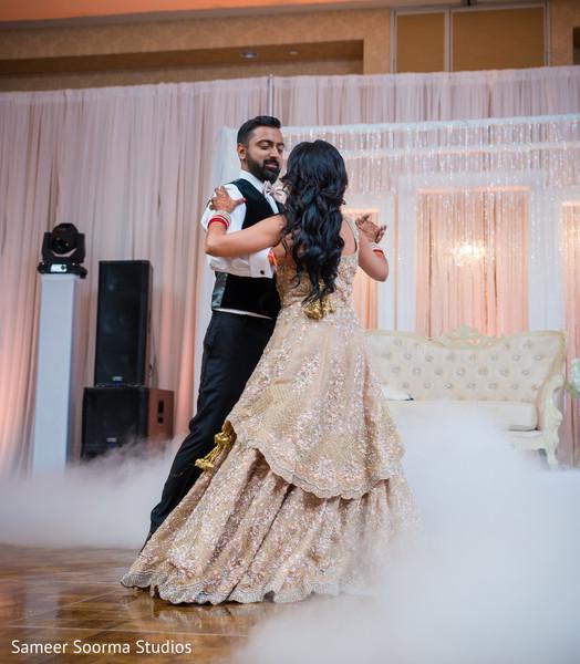 Indian bride dancing with groom