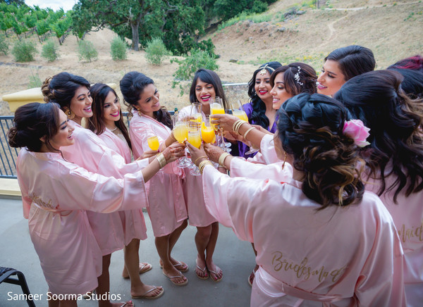 Indian bride and bridesmaids sharing a toast