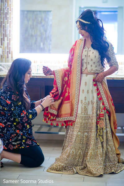 Artist assisting the Maharani with her wardrobe