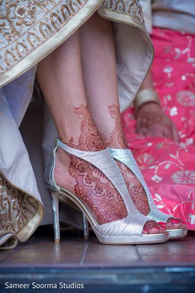 Indian bride showing her lovely mehndi design