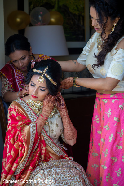 Maharani being assisted by family guest