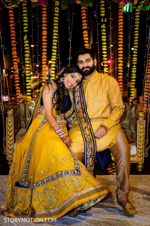 Stunning fashion for bride and groom's sangeet celebration.