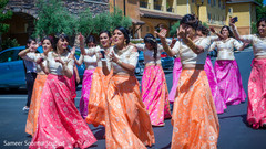 Indian bridesmaids dancing during baraat
