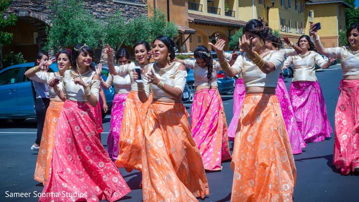 Indian bridesmaids dancing during baraat