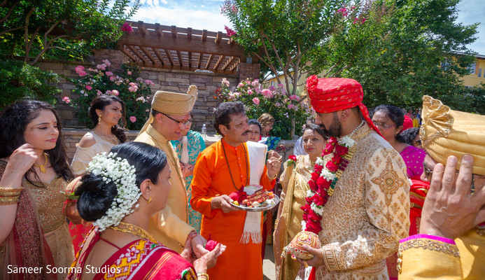 Family welcoming indian groom