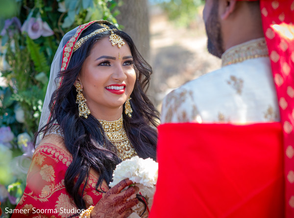 Indian bride sweetly looking at the groom