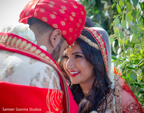Indian bride looking so in love