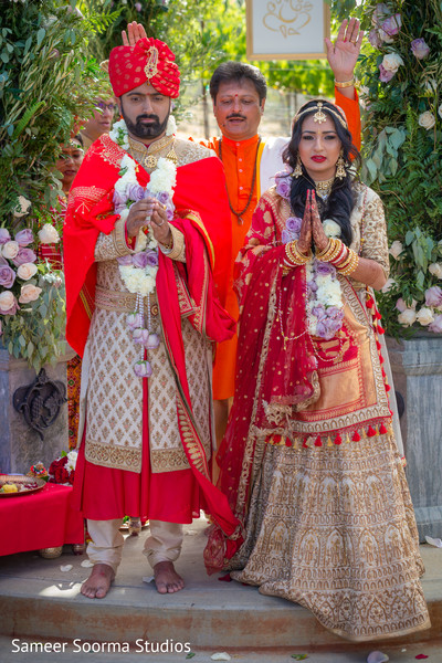 Indian bride and groom being blessed