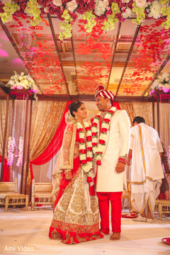 Dazzling Indian bride and groom at their ceremony.
