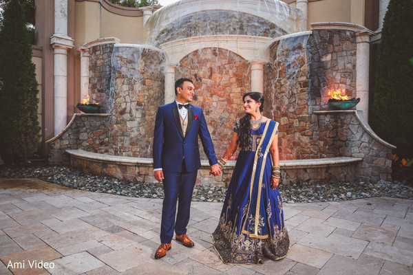 Lovely Indian couple at their wedding reception outfits.