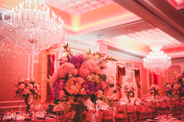 Incredible Indian wedding reception table flowers decor.