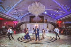 Stunning Indian  couple reception dance with groomsmen.