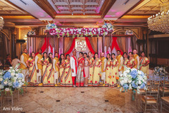 Indian couple with bridesmaids and groomsmen photo.