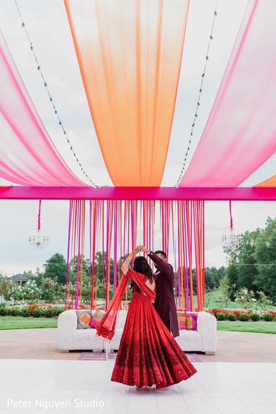 Maharani dancing with Indian groom outdoors