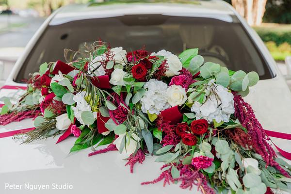 Floral arrangement details on couple's car