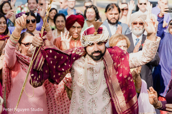Indian groom arriving with the fun baraat