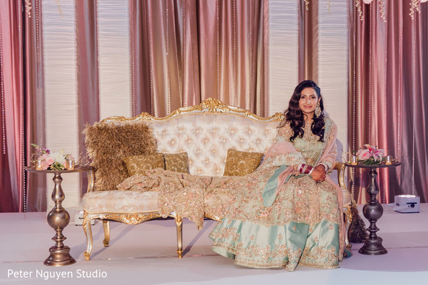 Indian bride posing for pictures during the reception
